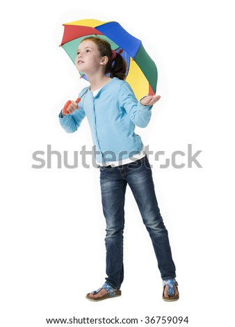 Young girl peering out from under colorful umbrella - stock photo