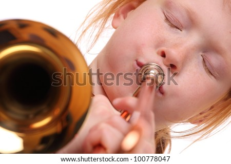 Young girl playing a trombone on white background - stock photo