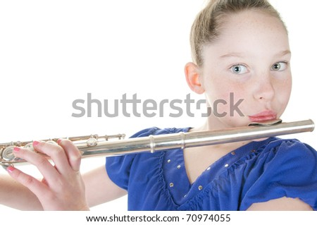 young girl playing flute instrument - stock photo