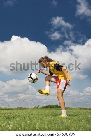young girl playing football - stock photo