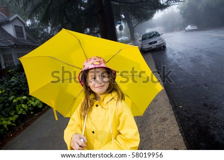 Young girl playing in rain 7 - stock photo