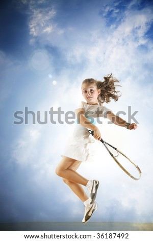 Young girl playing tennis - stock photo