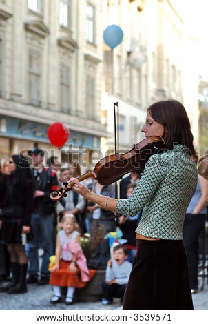 young girl playing violin - stock photo