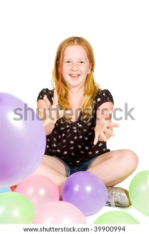 young girl playing with balloons isolated - stock photo