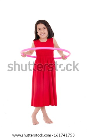 Young girl playing with hula hoop isolated over white background - stock photo