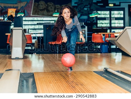 young girl plays bowling - stock photo