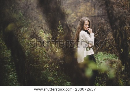 Young girl posing in autumn forest  - stock photo