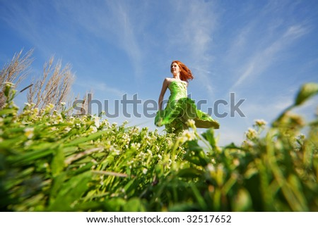 Young girl posing in field - stock photo