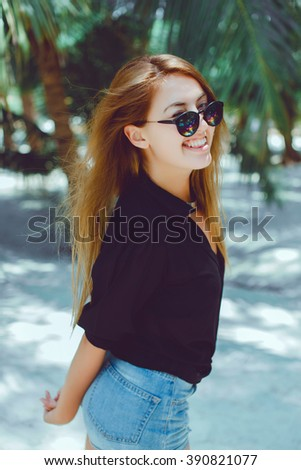 young girl posing in the beach, outdoor portrait - stock photo