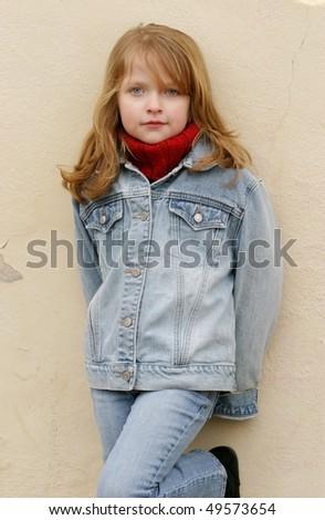 Young girl posing outside - stock photo