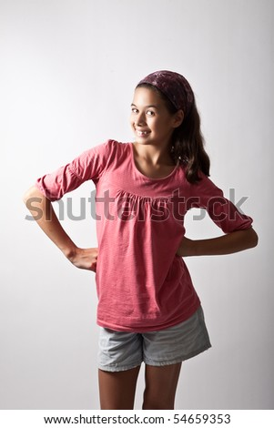 Young girl posing with hands on hip. - stock photo