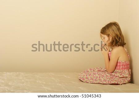 Young girl praying - stock photo