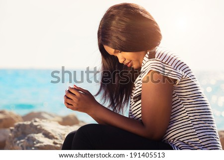 Young girl praying in nature by the Sea - stock photo