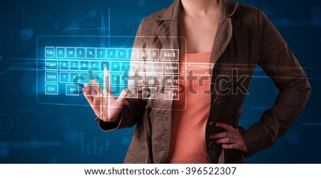Young girl pressing virtual type of keyboard - stock photo