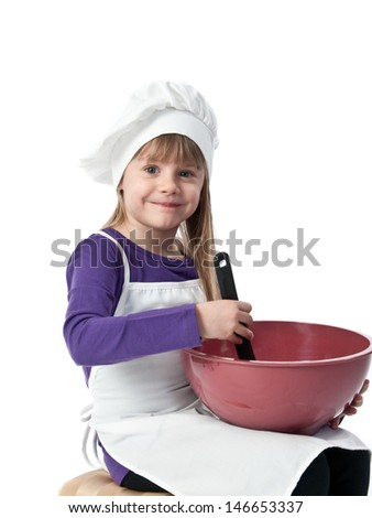 Young girl pretending to mix cooking ingredients in a bowl - stock photo