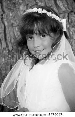 young girl ready for first holy communion - stock photo