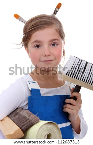 Young girl ready to decorate - stock photo