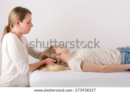Young girl receives head massage - stock photo