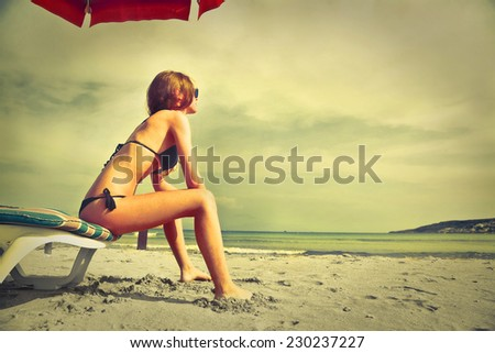 Young girl relaxing at the seaside  - stock photo
