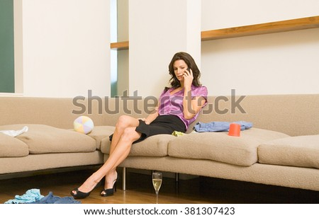 young girl relaxing on couch at home - stock photo