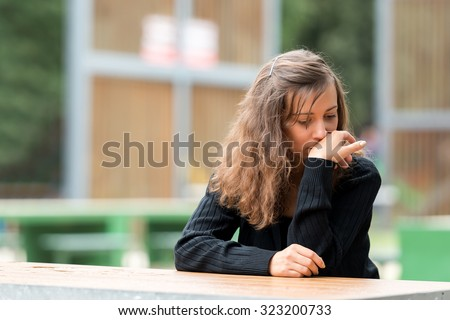 Young girl resting and regretting the made decision. - stock photo