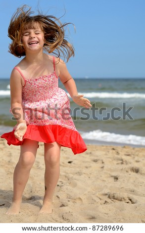 Young girl's beach expression - stock photo