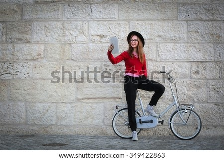 Young girl's bike ride - stock photo