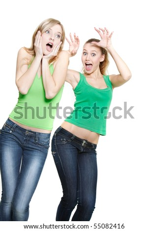 young girl scaring another one over white - stock photo