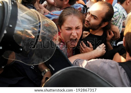 Young girl screaming in front of a police riot, during the ecological protest against construction work at the Bulgarian sea coast - Sofia, Bulgaria - 14, June 2012 - stock photo