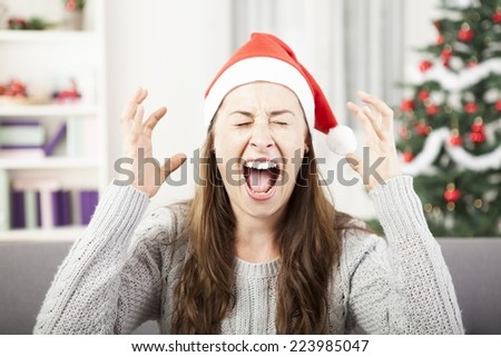 young girl screams because of bad christmas stress  - stock photo