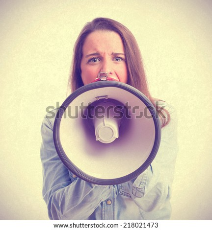 young girl shouting by megaphone - stock photo