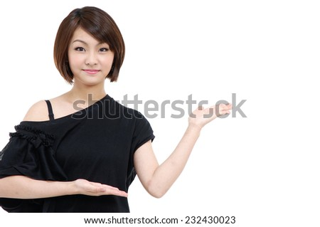 Young girl showing something on the palm of hand - stock photo