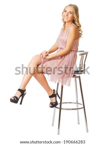 Young girl sit on chair isolated - stock photo