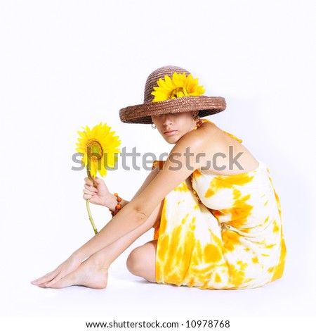 Young girl sitting and holding sunflower - isolated - stock photo