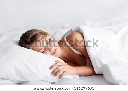 Young girl sleeping in bed - stock photo