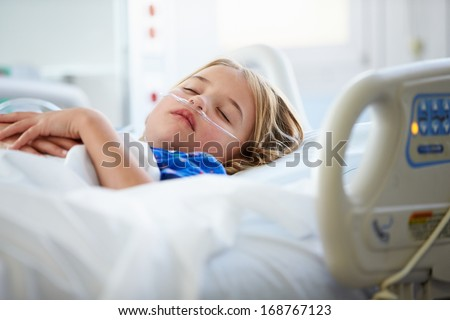 Young Girl Sleeping In Intensive Care Unit - stock photo