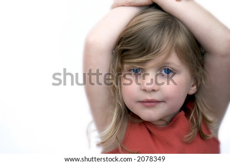 young girl smiling on white background - stock photo