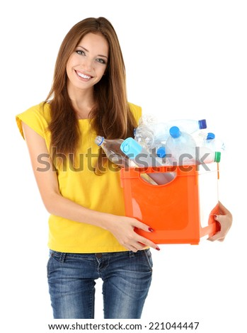 Young girl sorting plastic bottles isolated on white - stock photo