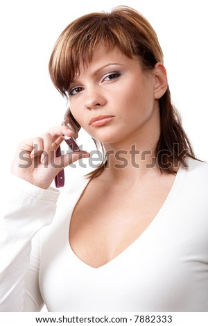 Young girl speaking on the telephone isolated at the white background - stock photo