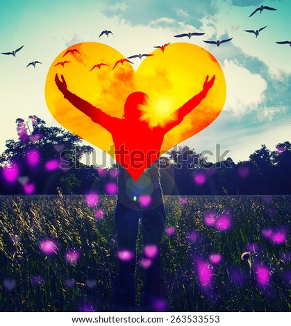 Young girl spreading hands with joy and inspiration facing the sun,sun greeting,freedom concept,bird flying above sign of freedom and liberty,with big orange heart and pink bokeh  - stock photo