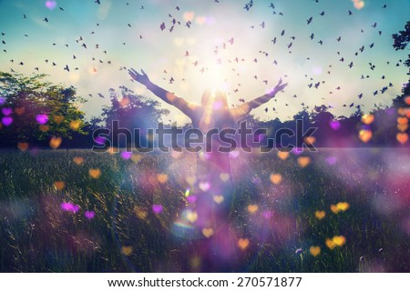 Young girl spreading hands with joy and inspiration facing the sun,sun greeting,freedom concept,bird flying above sign of freedom and liberty,heart bokeh - stock photo