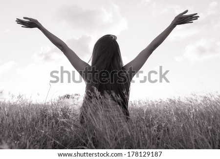 Young girl spreading hands with joy and inspiration. Freedom concept. - stock photo