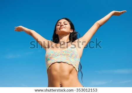 Young girl spreading hands with joy and smile on her face - stock photo