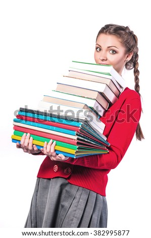 young girl standing with a bunch of books on an isolated background - stock photo