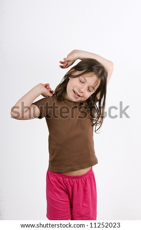 Young Girl Stretching - stock photo