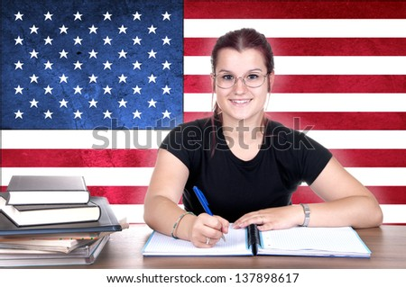 young girl student pc on the background with american flag. english language learning concept - stock photo