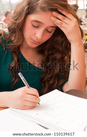 Young girl studying at esplanade - stock photo