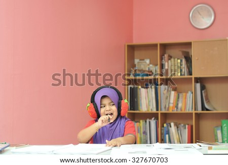 young girl studying with happy emotion - stock photo