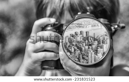 Young girl taking photos of New York by professional digital camera. - stock photo