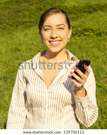 young girl talking on the phone. outdoor - stock photo